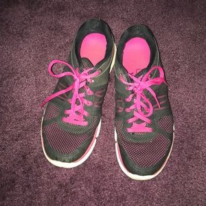 Pink and black nike sneakers